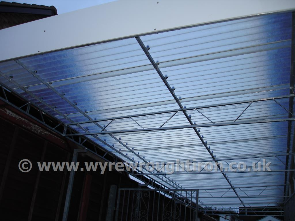 Detail of carport in Fleetwood showing steel structure and near transparent fibreglass roof.