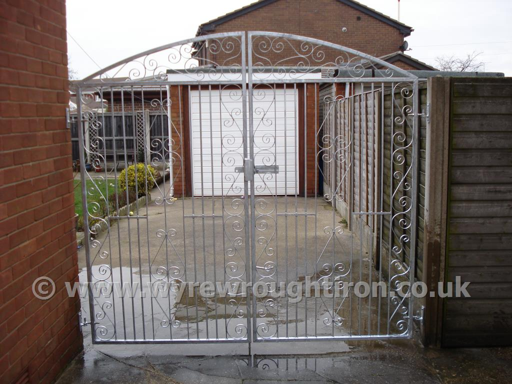 Tall double arched gates in Thames design with a galvanised finish, completed for a client in Bispham, near Blackpool.