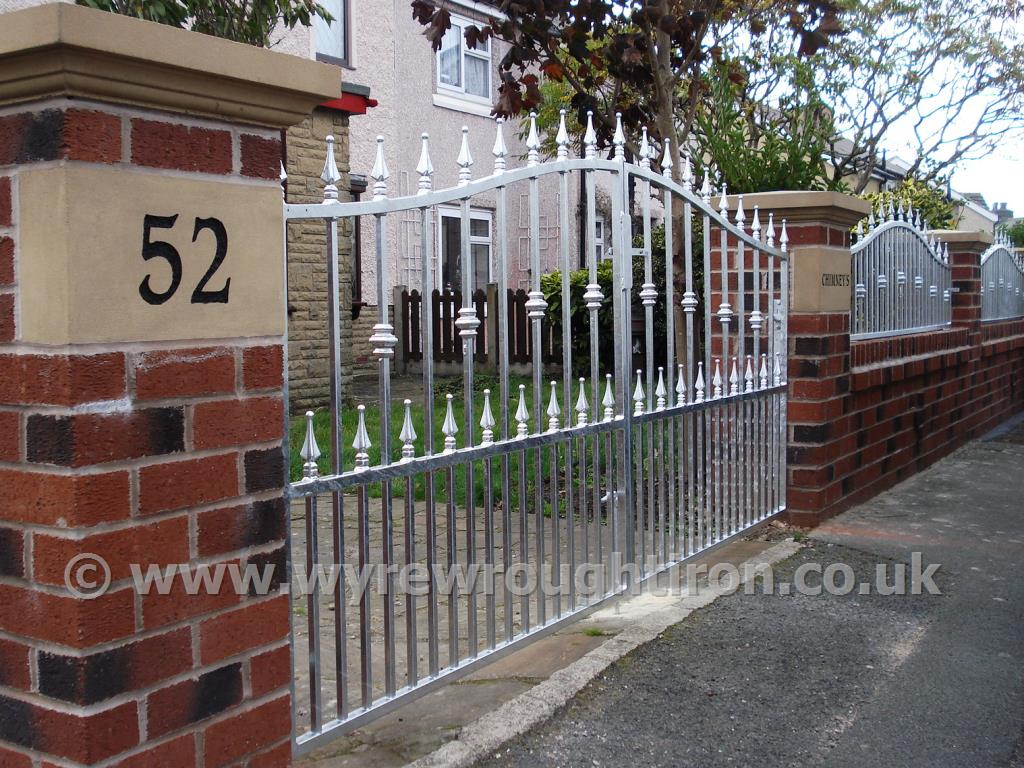 Photo - Double arch driveway gates with matching railings in galvanised finish, Fleetwood