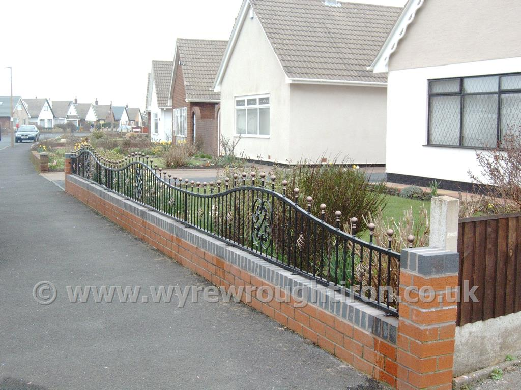 Arched top railings with ball railheads, cage twists, scrollwork and hand painted gold finishing, installed at Fleetwood property.