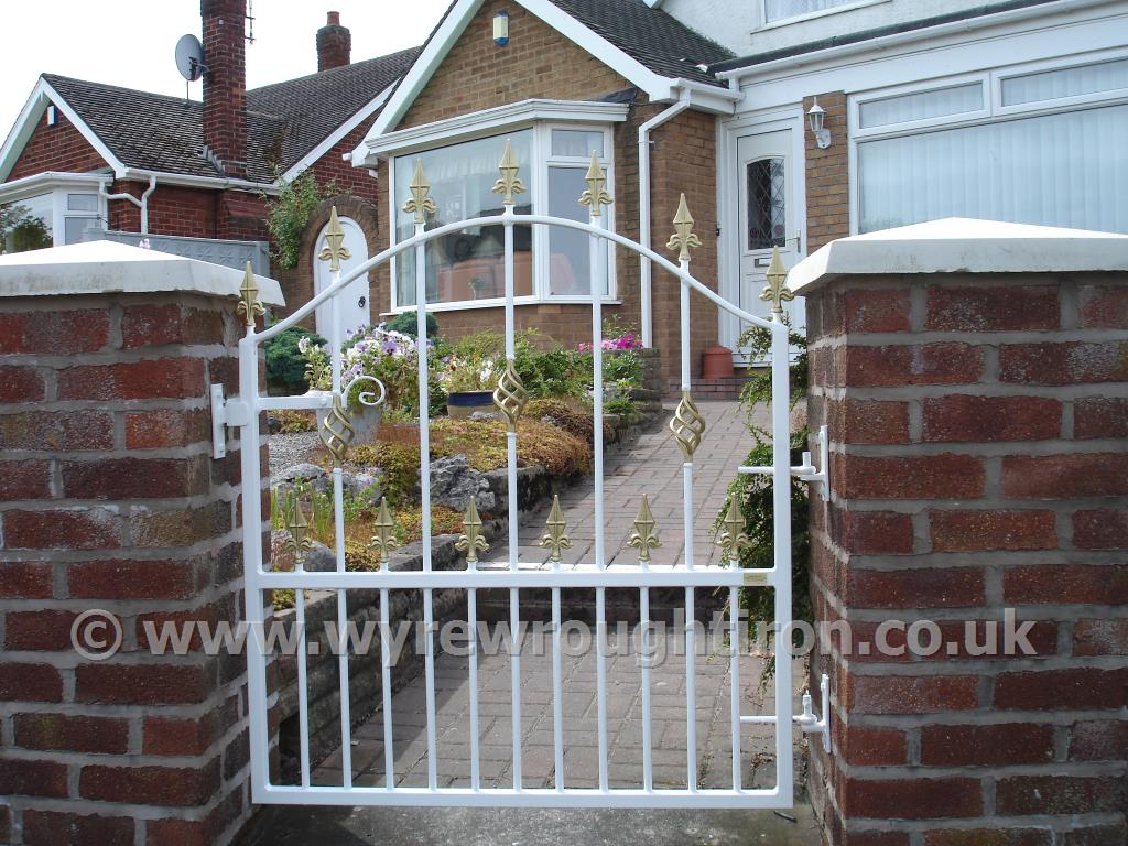 Single arch top gate, with railheads and cage twist. Galvanised, powder coated white and fitted in Poulton-le-Fylde.